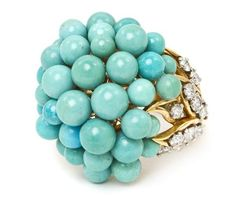 An 18 Karat Yellow Gold, Turquoise and Diamond Cluster Ring