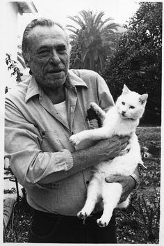 Charles Bukowski with his cat Manx.