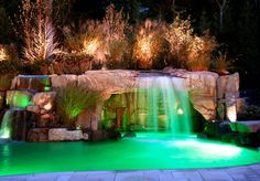 Custom swimming pool with artificial rock waterfall and grotto