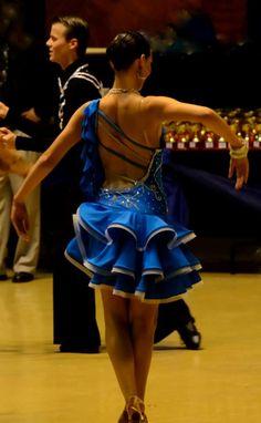 Latin dress with swarovski stoning and crinoline ruffle skirt