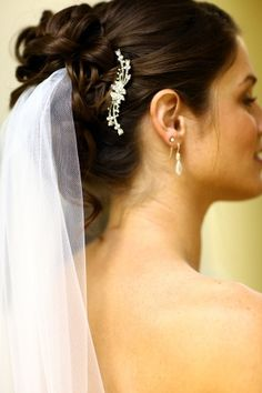 """Hair Style - that same broach is on my bridesmaid's dresses!  I like this idea - it """"ties"""" the designs together."""