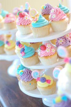 An array of pretty pastel cupcakes #cakedecorating Learn how to create your own amazing cakes: www.mycakedecorating.co.za #cupcakes #baking