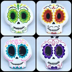"""Hand made and hand painted Day of the Dead Sugar skull decoration. Perfect as a wall hanging or for decorating your halloween tree! Skull is approximately 3""""tall by 3"""" wide and is hung on a 3"""" loop of black ribbon. Skull has been covered with a coat of clear resin gloss for protection and a high shine. This listing is for the Teal and Pink Skull ONLY but multiple skulls are currently available. Please contact me directly for special orders."""