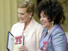 Dame Julie Andrews and Dame Elizabeth Taylor after they each received the honour of Dame Commander of the Order of the British Empire from the Queen at Buckingham Palace in 2000.