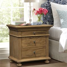 The Addington Hill night stand is larger than most bedside stands. The ample surface area is 32 inches wide by 20 inches deep. The dentil molding and bun foot add a classic touch.  ArmorTec finish.