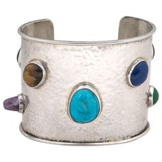 Sterling Cuff with Cabochon Stones | From a unique collection of vintage cuff bracelets at https://www.1stdibs.com/jewelry/bracelets/cuff-bracelets/