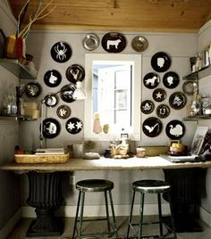 white silhouettes on black plates