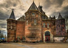 """The Waag (""""weigh house"""") is a 15th-century building on Nieuwmarkt square in Amsterdam. It was originally a city gate and part of the walls of Amsterdam. The building has also served as a guildhall, museum, fire station and anatomical theatre, among others.   The Waag is the oldest remaining non-religious building in Amsterdam. (Built in 1488!!!)"""