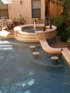 Pool with seats and hot tub