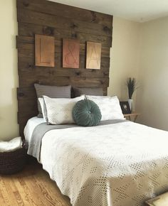 """DIY floor to ceiling wood headboard. Purchased plywood from Lowe's (picked out the ones with the most natural """"blemishes"""" to give it more of a reclaimed barn wood feel) and finished with a Walnut stain. Cheaper than buying a headboard and looks even better!"""