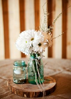 Wooden round + mason jar with floating candle + antique vase full of wild flowers = I think this is the one