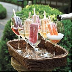 Proseco + Popsicles. huh. Why have I never thought of this? fun AND tasty. Maybe even make your own pops, with real fruit.