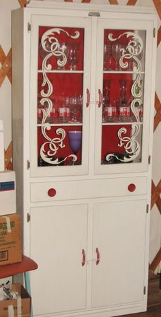 Just got this same antique Scheirich 1930's cabinet, can't wait to see it in my NEW red kitchen!!