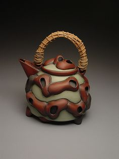 Stephen Robison (ClayGlazePots) | Teapot | Thrown and handbuilt with a woven cane handle and the surface is terra sigillata.