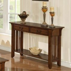 With a mission oak finish and classic silhouette, this lovely console table brings timeless style to any space. Top it with a bowl of glass orbs and bouquet of roses for an elegant display in the entryway or living room. Entryway Decor, Entryway Tables, Foyer Bench, Wood Furniture, Furniture Design, Traditional Console Tables, Wood Sofa Table, Sofa Tables, Superior Homes