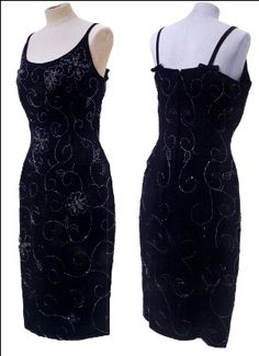 1950 / 1960. Marilyn Monroe black crepe material dress with handsewn bugle also black in the shape of flowewrs and leaves. The shoulders concist of straps with a small black bow on each strap. It has a zipper in the back and also two straps sewn inside to hang the dress.