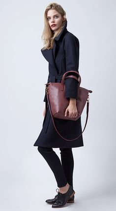 Our carryall totes are made to carry and love forever. Shown here with our wool coat in navy.