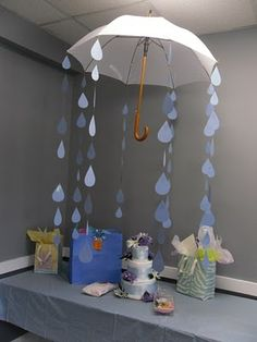 Shower--umbrella and paper rain drops make a wonderful baby shower party decoration.Baby Shower--umbrella and paper rain drops make a wonderful baby shower party decoration. Deco Baby Shower, Fiesta Baby Shower, Shower Bebe, Girl Shower, Shower Party, Baby Shower Games, Baby Shower Parties, Shower Gifts, Rain Shower