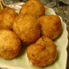 Italian Rice Balls Recipe Appetizers, Side Dishes with ground black pepper, salt, eggs, grated parmesan cheese, dried basil, white rice, dry bread crumbs, low sodium chicken broth, olive oil, mozzarella cheese