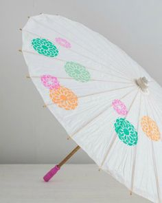 Martha Stewart Crafts Mad About DIY: Summer Outdoors Edition! How adorable is this painted parasol? So cute for a baby shower decor or wedding shower.