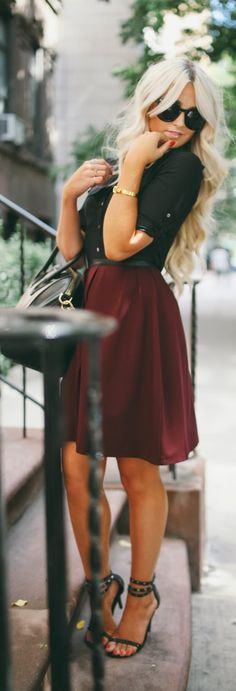 Gorgeous burgundy skirt and black top combo! Love this out fit and her hair!