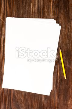Pencil and white card on wooden desk Royalty Free Stock Photo