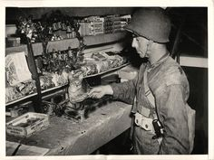 "1942- ""PX"", cat mascot, guards the till at the Post Exchange of a U.S. coast artillery outpost in Panama."