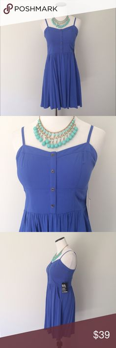 NWT EXPRESS Blue fit and flare Dress Brand new with tags. Size small. Adjustable straps. Dress has hidden pockets on sides. Fit and flare style. Back is gathered. Buttons on chest. Express Dresses