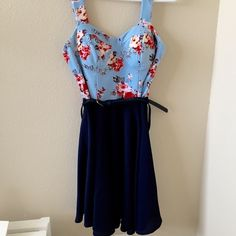 FINAL FLASH SALE! Floral Dress This floral dress is perfect for a summer party! Padded detail at the top, navy belt around the waist and a flowy navy bottom that makes it look like it is two pieces!    Size small   100% polyester  Hidden zipper on the back   Brand new! Charlotte Russe Dresses