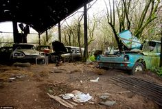 Scrap heap: The garage resembles something of a car graveyard, where classic models, including once pricey sports cars, have turned into battered shells over the years