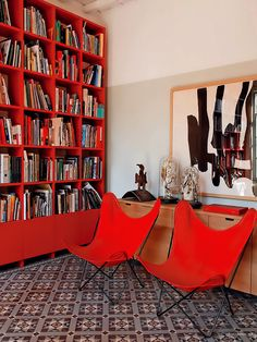 Library with red shelves & chairs