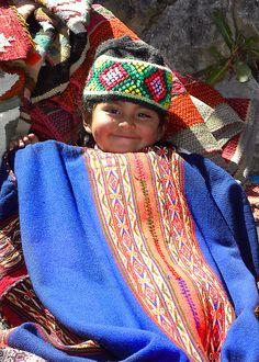 Bliss - Chinchero by Michael Sheridan.   A contented Quechua girl at the Sunday Market in Chinchero - Peru.