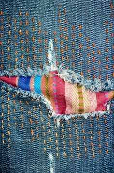 Fun visible mending on jeans: multicolored sashiko-style stitching and a colorfu. : Fun visible mending on jeans: multicolored sashiko-style stitching and a colorful striped patch Sashiko Embroidery, Japanese Embroidery, Embroidery Stitches, Hand Embroidery, Embroidery On Jeans, Embroidery Designs, Embroidery Supplies, Cross Stitches, Diy Embroidery On Clothes