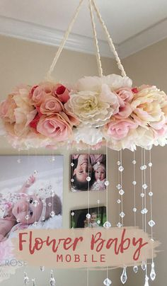 Add a touch of elegance to any room with this vintage floral mobile featuring high-quality faux blooms (shown in ivory and pink) with dangling luminescent crystal acrylic beads and teardrop ends nursery decor | nursery design | nursery ideas | baby mobile #Ad