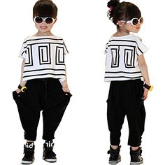 Girls' Summer Fashion Clothing Set Short-Sleeve Top and Black Pants. Machine Wash. Two-piece set featuring short-sleeve fashion T-shirt, and black 3/7-length Harem pants. Super cute,stylish. Great gift. Made in China.