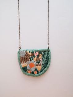 embroidered pendant. LanaPelana Jewelry