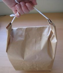tie a handle on a paper bag; simple interesting, easy to modify