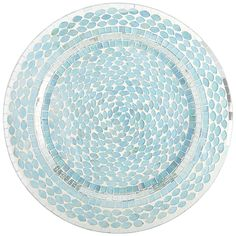 Set the summer table you've always dreamed of—our glittering Mosaic Charger makes even the most casual setting spectacular. Bits of hand-applied glass in turquoise and silver shimmer like sunlight on an ocean wave.