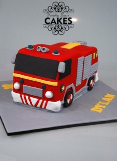 A fourth birthday cake made of layered choc mud and ganache. I got a general idea from cartoon pictures of the fireman same fire truck and used a little creative license.