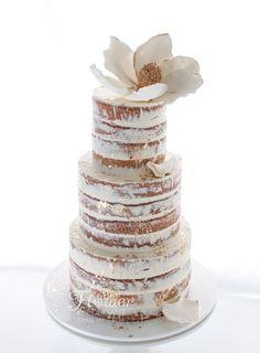 Wedding Cake - semi-naked vanilla cake with white & gold magnolia.