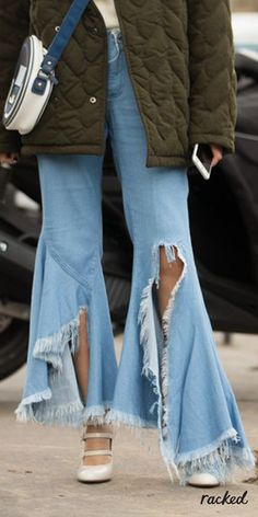 Cool Torn Flare Jeans at at Paris Fashion Week // More Transitional Style Ideas from the Best PFW Fall 2016 Street Style: (http://www.racked.com/2016/3/3/11151322/pfw-fall-2016-street-style)