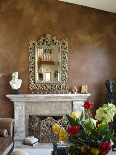 a multi fauxed wall with a fireplace that has relief designs