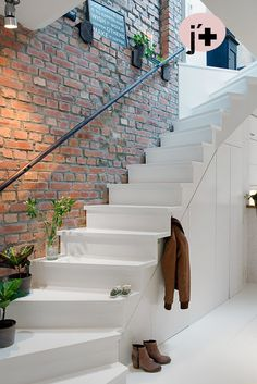 Brick wall and wooden stairs with cabinets