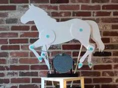 Horse automata Dec 16, 2013 Library display, controlled by Arduino and proximity sensor. Cardboard rivets from MakeDo.