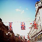I took this photo on the May Day bank holiday - it was very cool to see that the bunting for the Royal Wedding was still up!  This was Regent Street in London.