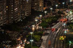 Aerial view at famous Copacabana Rio de Janeiro - Driving cars in the street at night with market tents, Rio de Janeiro in Brazil, city of international world sport games 2016