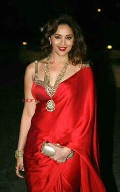 From Trusted Store Red Saree is Sleeveless Blouse Saree worn by Madhuri Dixit with Stone Work Embroidery. Bollywood Saree, Bollywood Fashion, Bollywood Bikini, Indian Dresses, Indian Outfits, Sari Bluse, Madhuri Dixit Hot, Satin Saree, Saree Look