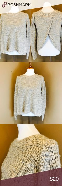 """Banana Republic Open Slit Back Sweater M Gorgeous sweater by Banana Republic Classic Carmel Color with Silver metallic threaded throughout Size Medium Measures approx 20"""" across the bust and 23"""" long Features a slit open butterfly back Gently pre-owned and ready to wear Banana Republic Sweaters Crew & Scoop Necks"""
