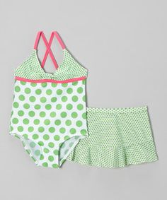 For swimming sweeties who can't resist bringing a girly twirl to the beach, this sun-loving suit has a matching skirt. It keeps little mermaids cute and covered, pairing perfectly with the one-piece's playful print.