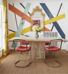 This dining room from #HGTVMagazine features an abstract mural of crisscrossing stripes. Click the #linkinbio to see more!